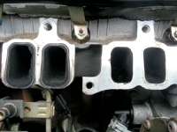 View of clogged inlet ports on Ford engine